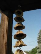 Clay bells - pretty hanging in my porch corner.